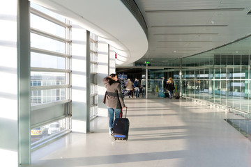 Business travel with luggage on the airport
