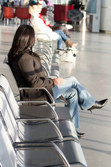 Businesswoman waiting for a plane at airport