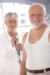 Smiling old man waiting for examination