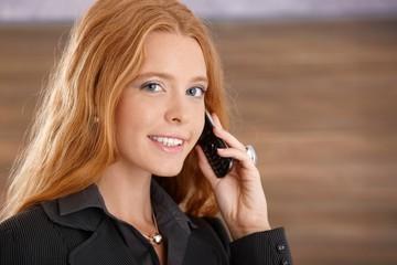 Happy businesswoman on phone call