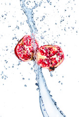 Deurstickers Opspattend water Fresh pomegranate in water splash