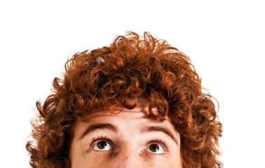 Redhead man looking up