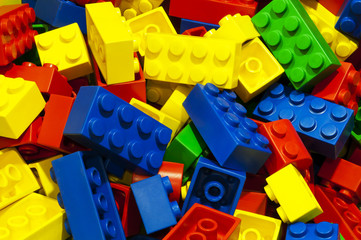 a lot of unsorted colored bricks