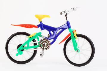 colorful plastic toy two-wheeled bicycle on white