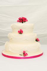 Wedding cake with pink decoration.