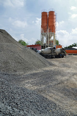 The Construction yard wit cement silo and truck