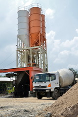 Industrial photo of a cement truck at cement silo yard