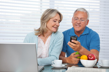 Man Showing Phone to his Wife