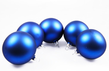 Blue matt christmas balls on white with space for text
