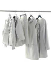 White fashion clothes on hangers