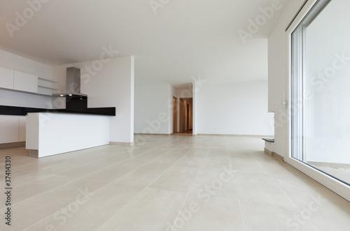 sala moderna con camino e cucina\