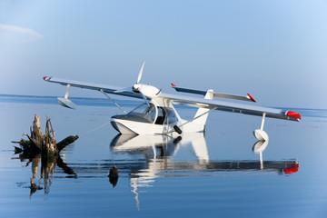 white seaplane reflection and blue lake