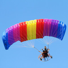 Türaufkleber Luftsport Colorful paraglider on blue bright sky