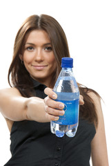 Woman  with bottle of drinking water nutrition fact
