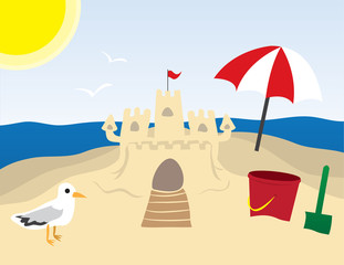 Beach scene with sandcastle and ocean in the background.
