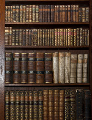 Foto op Textielframe Bibliotheek historic old books in old shelf library