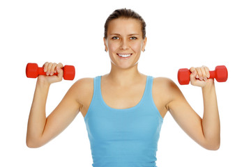 Girl with barbells in front of white background