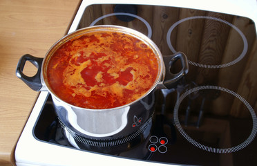 Soup cooks on an electric plate