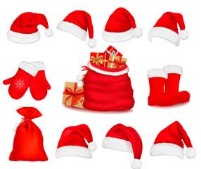Big set of red santa hats and clothing. Vector