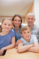Portrait of a family posing in a kitchen