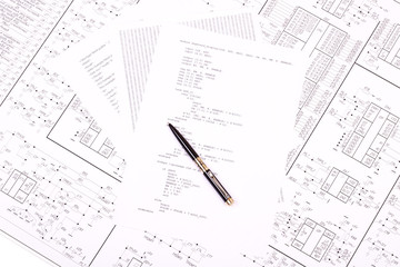 Pen on paper with the program and drawing of electrical circuits