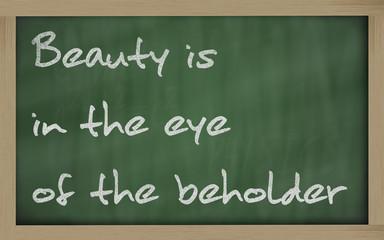 """"""" Beauty is in the eye of the beholder """" written on a blackboard"""