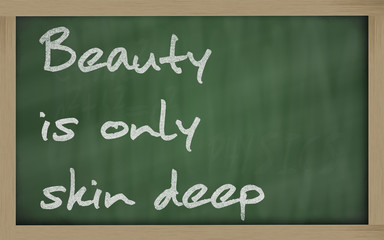 """"""" Beauty is only skin deep """" written on a blackboard"""