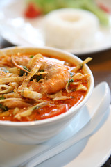 Tom Yum soup , a Thai traditional spicy prawn soup with rice