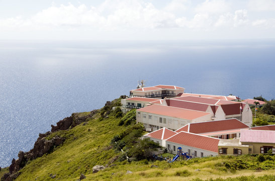 """village typical architecture on cliff over Caribbean Sea on """"Th"""