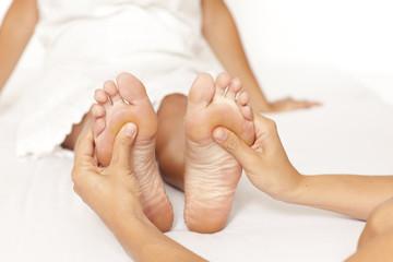 Human hands massaging a woman's foot