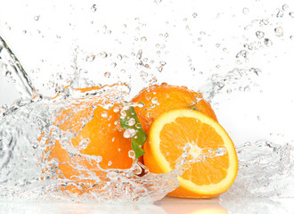 Wall Murals Splashing water Orange fruits with Splashing water