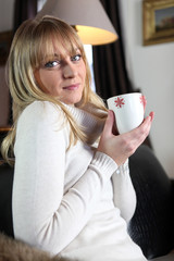 Woman having a hot cup of tea