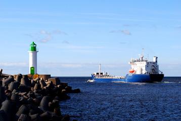 cargo ship leaving port. Ventspils, Lativa