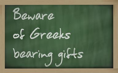 """""""   Beware of Greeks bearing gifts """" written on a blackboard"""