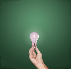 Bright idea lightbulb in hand