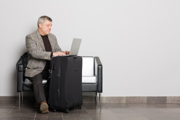 Middle aged man using a laptop.
