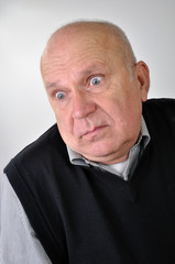 senior man with puzzled expression