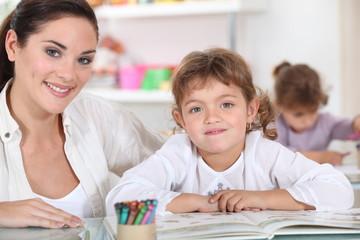 Little girls drawing in class