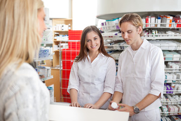 Pharmacists with Female Customer