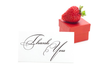 red gift box, thank you card and strawberries isolated on white