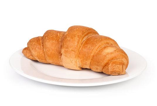 fresh croissant on plate