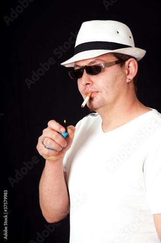 Junger Mann Mit Hut Und Zigarette Stock Photo And Royalty Free
