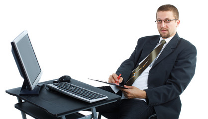 Businessman writing and working on computer