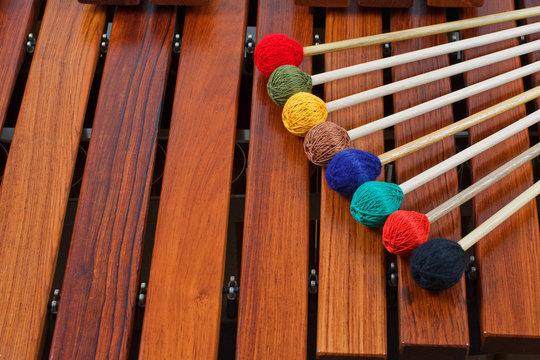 Coloured mallets on marimba