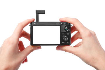 Closeup image of two hands black compact digital photo camera wi