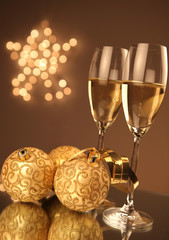 Christmas glasses of Champagne and golden background