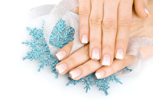 hands with beautiful winter design, snowflakes and ribbon