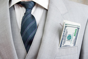 Man with a suit and money in pocket