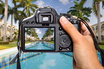 DSLR  camera in hand shooting tropical resort scenery (my photo)