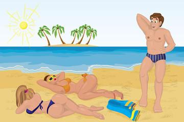 Man met two sunbathing girls on the beach